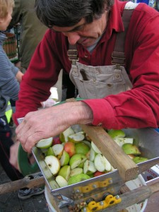 Crushing apples into a pomace